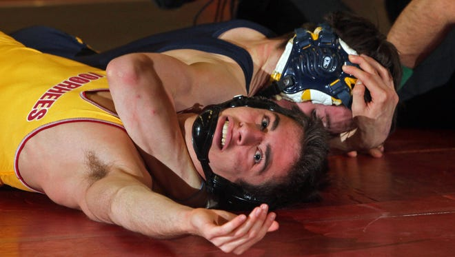 Delaware Valley's Matthew Kolonia pins Voorhees' Harley Sacks in this 126 pound bout, in action of Region V wrestling at Hunterdon Central High School in Flemington.