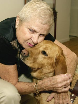 Edith Kling cuddles her guide dog Frances in a 2005 file photo.