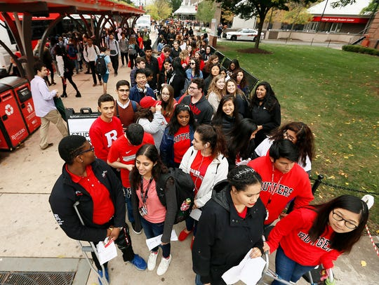 Students line up outside College Avenue Gym to see