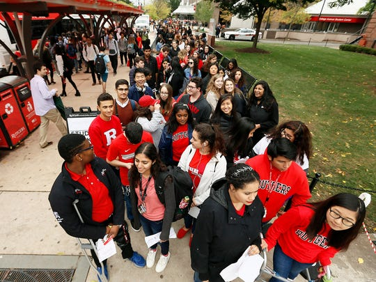 Students line up outside College Avenue Gym to see Joe Biden, the 47th vice president of the United States speak on 'ItÕs On Us,' a national campaign to end sexual assault on college campuses during his visit to Rutgers University. The campaign was launched in 2014 following recommendations from the White House Task Force to Prevent Sexual Assault. October 12, 2017. New Brunswick, New Jersey