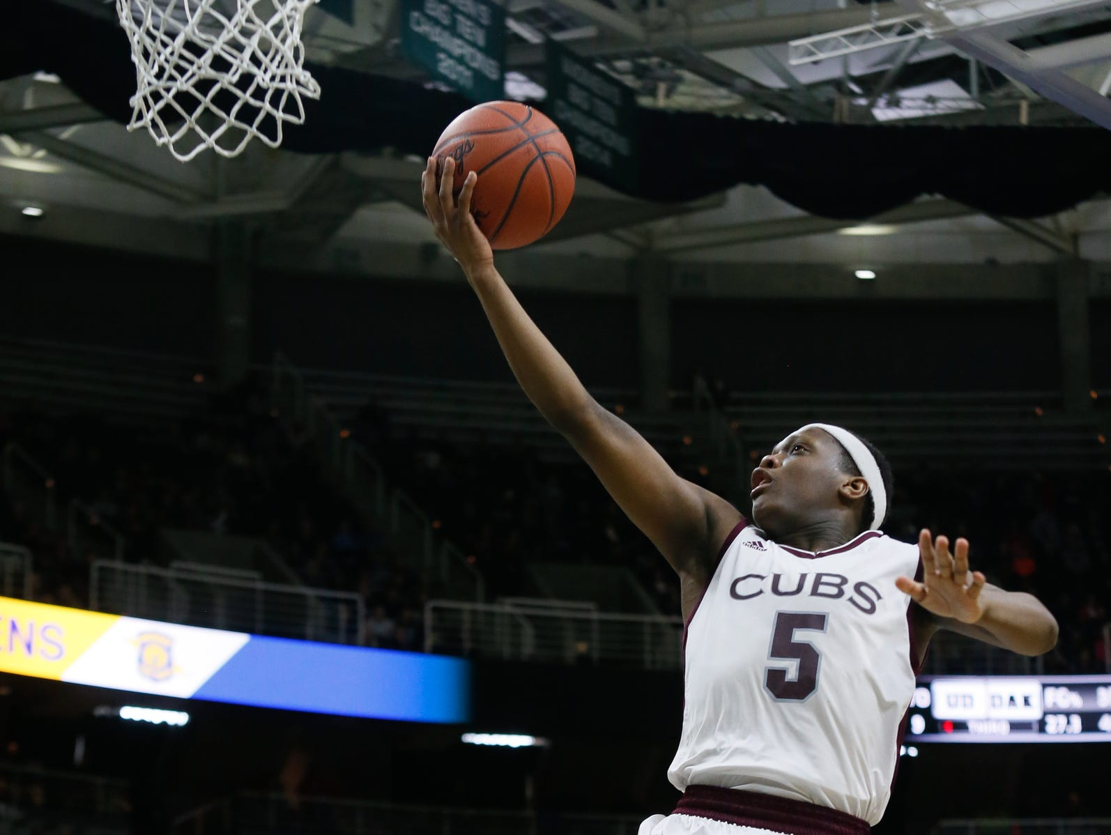 Detroit U-D Jesuit's Cassius Winston makes a layup against Macomb Dakota during the MHSAA boys basketball Class A semifinals at the Breslin Center in East Lansing, Mich. on Friday, March 25, 2016.