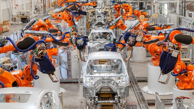 Robots assemble steel parts made by Magna International  at BMW's X4 body shop in Greer.