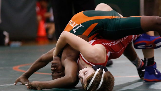East Ramapo's Elijah Whitehead and North Rockland's Joe Henion wrestle a 99-pound match in the Section 1 Dual Meet Championships at East Ramapo High School in Spring Valley on Wednesday, December 7, 2016.  .