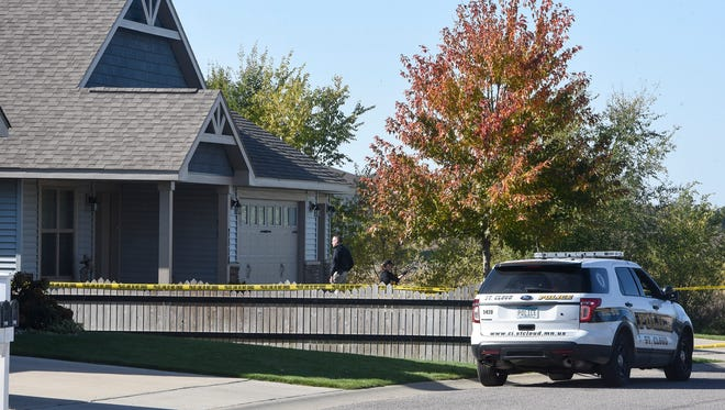 Crime scene investigators walk toward a home on the 7000 block of Northwood Lane Tuesday, Oct. 17, in St. Cloud.