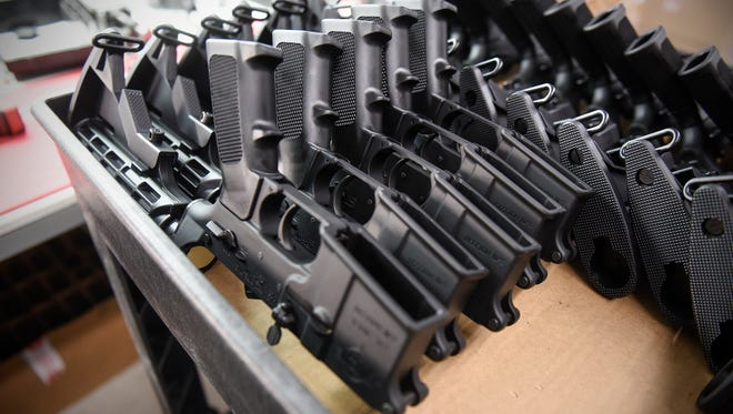 AR-15 parts are stacked for assembly at Alex Pro Firearms Friday, April 13, near Alexandria.