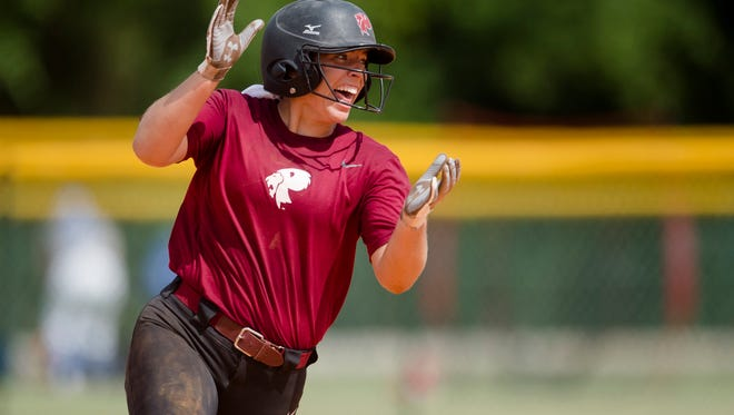 Prattville's Emma Hindi celebrates hitting a 3-run home run during the AHSAA Class 7A Softball State Championship tournament game between Prattville and Fairhope on Wednesday May 16, 2018, in Montgomery, Ala.