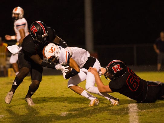 Dickson County's Tristen Corlew, 3, gets tackled by