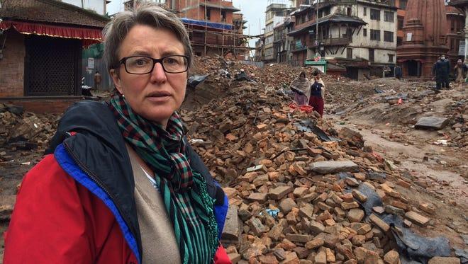 Donatella Lorch amid the destruction in Darbar Square, Kathmandu, Nepal.