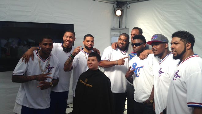 David Herzog, 11 of Chili with Andre Reed and the barbers of Signature Cutz.