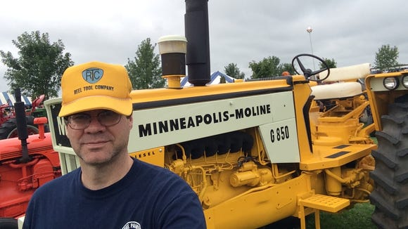 Me, posing as someone who actually works for a living. I'm wearing the hat of my uncle John Reel's machine shop, and standing in front of a Minnapolis-Moline tractor. My grandpa, Roland Reel, had one like it; it was my favorite.