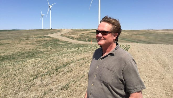 Martin Wilde stands at the Fairfield wind farm last year. Construction of Glacier wind farm, which is next door to the Fairfield project, is back on track, Wilde said.