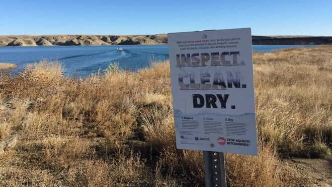 """A sign at Tiber Reservoir is part of a statewide information effort developed by Montana Fish, Wildlife and Parks and the Montana Department of Agriculture encouraging Montanans and visitors to """"Inspect, clean, and dry"""" boats, trailers and fishing gear to """"Stop Aquatic Hitchhikers!"""" FWP is proposing mandatory inspections of boats traveling across the Continental Divide into the Columbia River Basin, and mandatory inspections of out-of-state boats launching in Montana."""