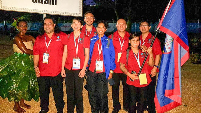 Team Guam at the opening ceremonies of the 10th Pacific Mini Games in Port Vila, Vanuatu. Shown from left are Caesar Whitt, Judo officla, Deja Whitt, judo, Taylor Whitt, judo, Dr. Ariana Adolphson, team doctor, Edgar Molinos, weightlifting official, Jacinta Sumagaysay, weightlifting, and Joey Miranda III of the Guam National Olympic Committee. The beach volleyball athletes, Tatiana Sablan and Kendra Byrd, were en route during the ceremonies and the athletics contingent - Athan Arizanga, Shania Bulala, Genina Criss and Amanda Cruz - depart Guam on Dec. 8.