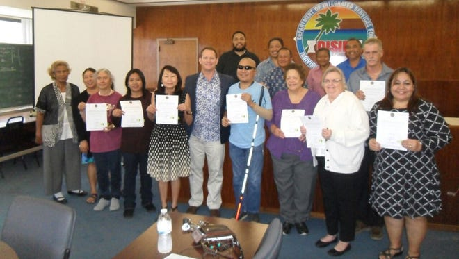 On March 15, the Guam State Rehabilitation Council held their General Membership Meeting and a Swearing Ceremony for newly appointed Council Members at the Division of Vocational Rehabilitation Conference Room. Pictured in front from left: Josepha Pedro; Jirrah Bautista; Barbara Johnson; Leah Abelon, Outreach Committee Chairperson; Lourdes Ann Mesa, SRC Chairperson; Honorable Ray Tenorio, Lieutenant Governor; Rodney Calimlim; Jeanette Yamashita, Planning & Resources Development Committee Chair; Carol Darlow;  Marie Libria. (Back, L-R) Evangelis Babauta, ASL Interpreter; Peter Barcinas, SRC Secretary; Benito Servino, Director, Department of Integrated Services for Individuals with Disabilities; Gina Arca; Eddy Reyes, SRC Secretary; and Tim Murphy.