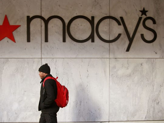 A pedestrian passes a Macy's store along the Magnificent Mile in Chicago.
