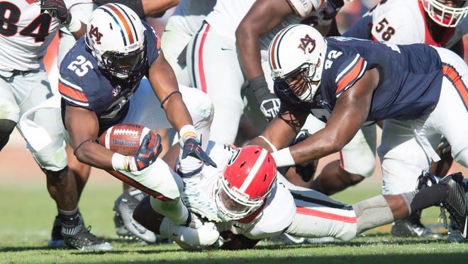 Auburn Tigers running back Peyton Barber (25) dives forward during the the NCAA football game between Auburn Tigers and Georgia on Saturday, Nov. 14, 2015, in Auburn, Ala. Georgia defeated Auburn Tigers 20-13.