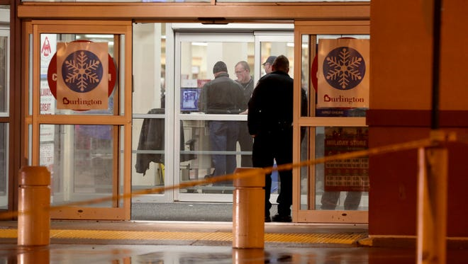Police review security camera footage on a monitor inside the Burlington Coat Factory store at Eastland Center in Harper Woods on Saturday, Dec. 26, 2015.