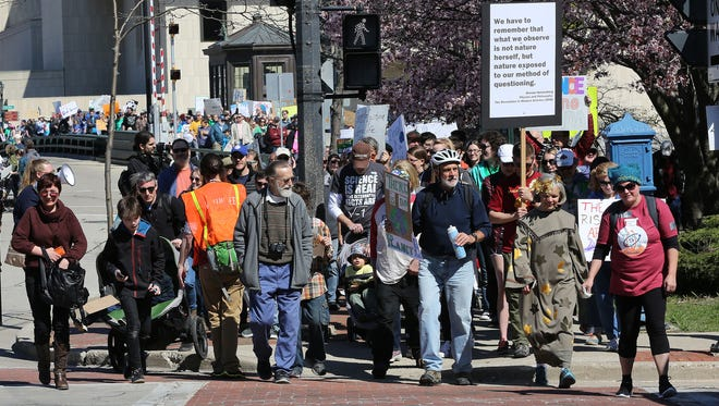 A large group left from a rally at Red Arrow Park in Milwaukee's March for Science, which took them to the Milwaukee Public Museum and back Saturday afternoon.