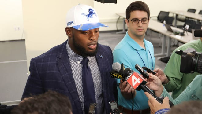 Lions first round draft pick Jarrad Davis talks to reporters at the Allen Park practice facility Friday, April 28, 2017.