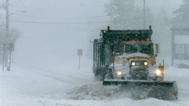 A snow plow works along Airport Road in Lakewood Thursday morning, January 4, 2017.