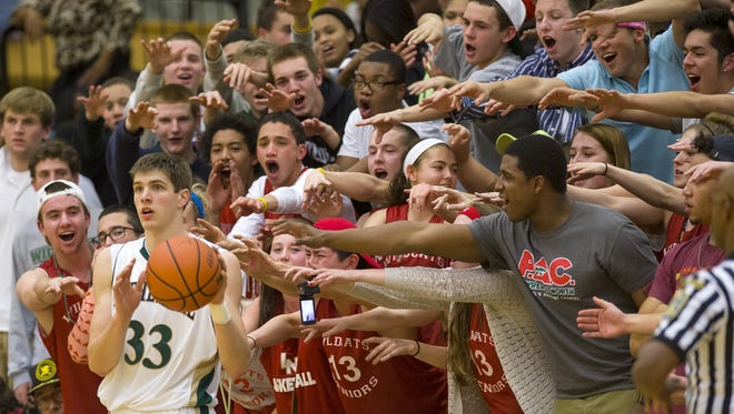 Sectional time! Lawrence North fans tried to influence the in-bound pass of Cathedral's Collin Hartman during the first-round of the 2013 IHSAA Boys' Basketball Sectionals.