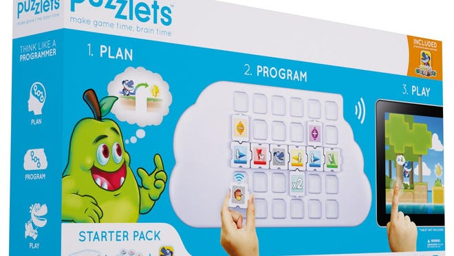 """The Puzzlets Starter Pack from Digital Dream Labs includes a """"Cork the Volcano' game download, 22 programming tiles, the play tray, a USB cable and a storage pouch."""