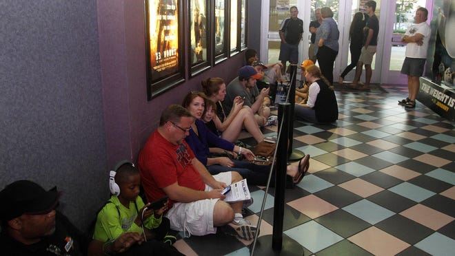 """Movie goers waited in line before the opening of the new motion picture """"Stars Wars: The Force Awakens"""" Thursday night at the Regal Theater at the Bell Towers in Fort Myers."""