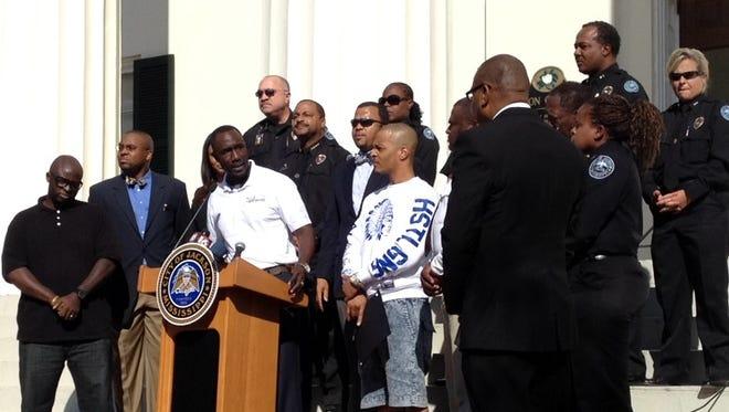 Jackson Mayor Tony Yarber introduces T.I. at a ceremony at City Hall.