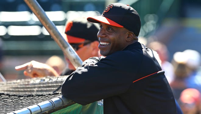 San Francisco Giants former outfielder Barry Bonds laughs during batting practice prior to the game against the Chicago Cubs at Scottsdale Stadium.