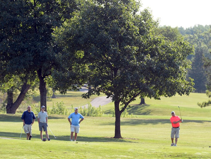 Dave Short, left, Andrew Coleman, and Jeff Mullin watch as Del DeMao tees off on no. 2 while playing in the 2014 Men's City Amateur Golf Tournament at Highland Lake Saturday, Aug. 16, 2014.