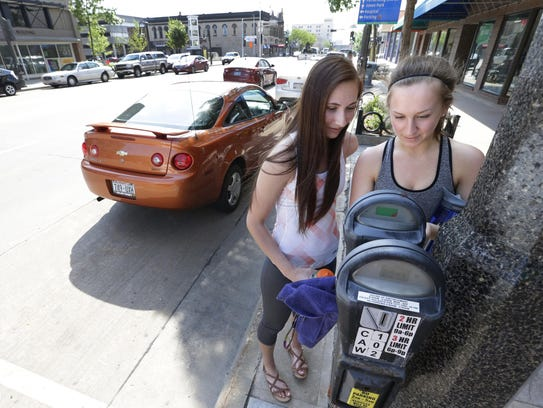 Kaylie Nytes (left) and Emily Paul of Kaukauna feed