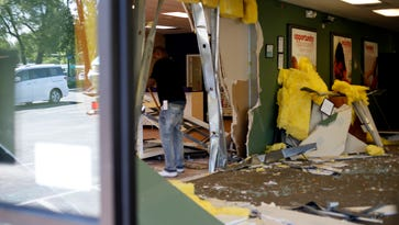 Van crashes through one Springfield business, into another