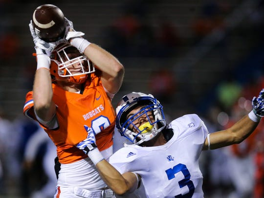 Maverick McIvor elevates over a Frenship defender last year to make a catch. He was a starting wide receiver as a sophomore and is set to move into the starting quarterback role.