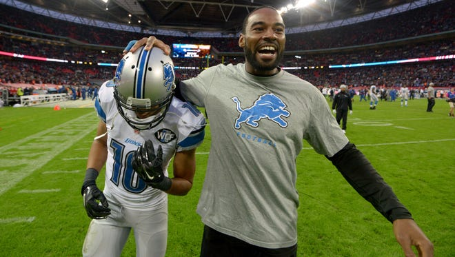 Detroit Lions receiver Calvin Johnson (right) celebrates with receiver Corey Fuller (10) after the NFL International Series game against the Atlanta Falcons at Wembley Stadium. The Lions defeated the Falcons 22-21.