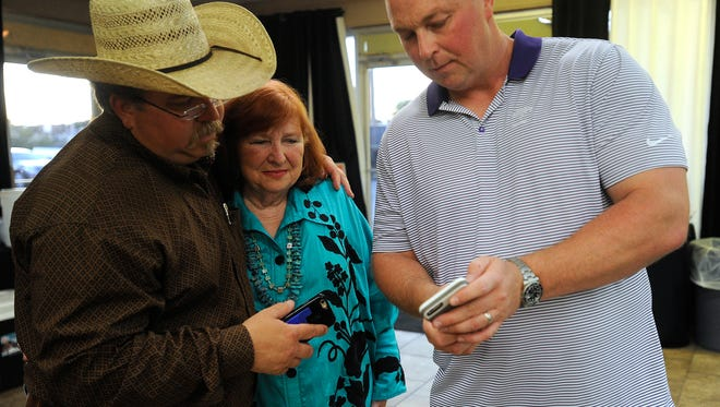 Abilene City Council candidate Donna Albus (center) looks over election results with her son, Damon (left), and treasurer Myrick Gloyna during her campaign party on Saturday, May 6, 2017. Albus won the election with 54.3% of the vote.