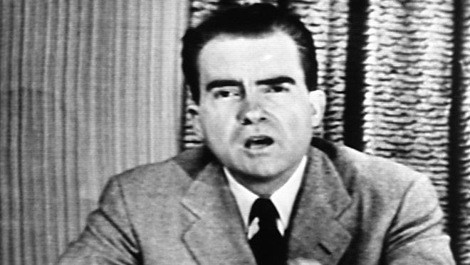 """Richard Nixon, Republican candidate for vice president, explains an $18,000 expense fund on national television on Sept. 23, 1952. The appearance was nicknamed his """"Checkers"""" speech because of his reference to the family dog, the one contribution he admitted receiving from a Texas supporter."""