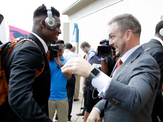 Oct 6, 2018; Dallas, TX, USA; Texas Longhorns linebacker Joseph Ossai (46) is greeted by head coach Tom Herman before the game against the Oklahoma Sooners at the Cotton Bowl. Mandatory Credit: Tim Heitman-USA TODAY Sports