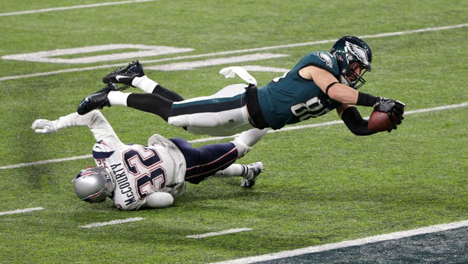 Feb 4, 2018: Philadelphia Eagles tight end Zach Ertz (86) scores a touchdown over defender New England Patriots free safety Devin McCourty (32) during the fourth quarter in Super Bowl LII at U.S. Bank Stadium.