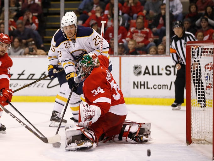 Buffalo Sabres' Sam Reinhart (23) can't get a shot
