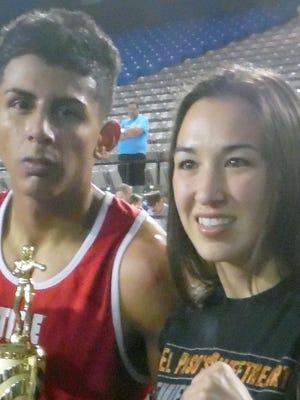Unbeaten Jorge Madrid poses with IBF World Champion pro boxer Jennifer Han following his victory last week in El Paso.
