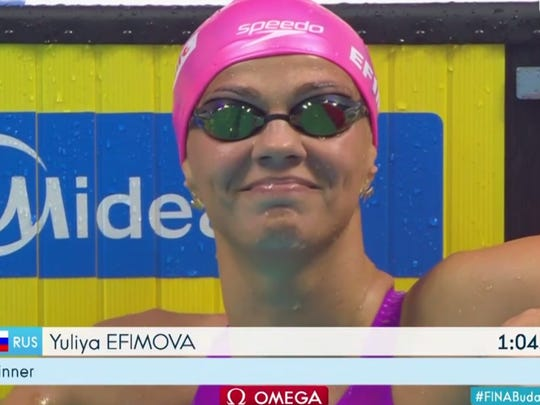 In this screengrab from an NBC Sports video, Yuliya Efimova gives a finger wag after nearly tying the world record in the 100-meter breaststroke.