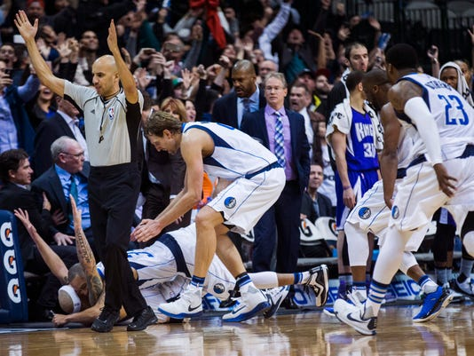 Dallas Mavericks guard Deron Williams (8) is mobbed by his teammates after scoring a 3-pointer in the final second of the second overtime in an NBA basketball game against the Sacramento Kings on Tuesday, Jan. 5, 2016, in Dallas. The Mavericks won 117-116. (Ashley Landis/The Dallas Morning News via AP) MANDATORY CREDIT; MAGS OUT; TV OUT; INTERNET USE BY AP MEMBERS ONLY; NO SALES