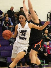 Mescalero's Lauryn Yuzos, left, tries to dribble past a Fort Sumner defender.