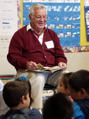 Tom Drilling reads to second-graders at Roosevelt School on 2006. Drilling was selected as 2014 Tulare Man of the Year.