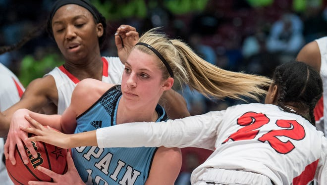 Spain Park's Sarah Ashlee Barker is double teamed by Lee's Dalayiah Crawford and Diamond Williams (22) at their AHSAA State Semi-Final game at Legacy Arena in Birmingham, Ala. on Thursday March 1, 2018.