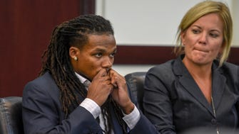 Brandon Banks kisses a religious bracelet he's had with him throughout the trial as the verdict is read in his trial in the Vanderbilt rape case at Justice A. A. Birch Building Friday, June 23, 2017, in Nashville, Tenn.