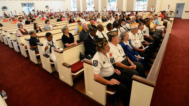 A crowd gathers at Naval Aviation Memorial Chapel aboard Pensacola NAS on Monday in honor of military men and women who have served their country during a Memorial Day service.
