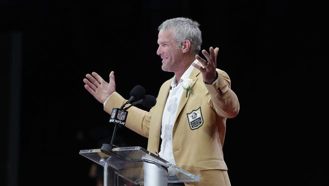 Brett Favre acknowledges the applause during his induction speech at the Pro Football Hall of Fame induction ceremony in Canton, Ohio on August 6, 2016.