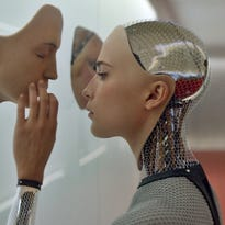 "The robot Ava (Alicia Vikander) ponders what it means to be human in ""Ex Machina."""