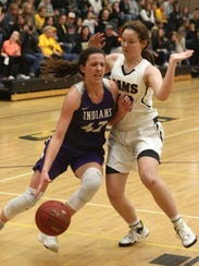 Indianola senior Grace Berg tries to get past Southeast